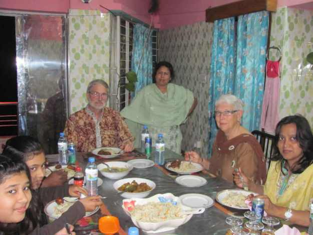 Eating dinner at Aungti's home. Her mom and dad serve us while we guests eat