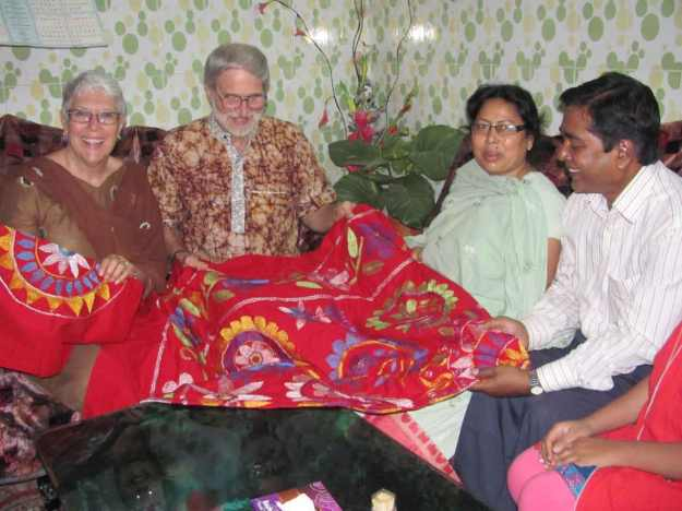 Aungti's parents present to us a lovely hand embroidered bedspread and pillow shams