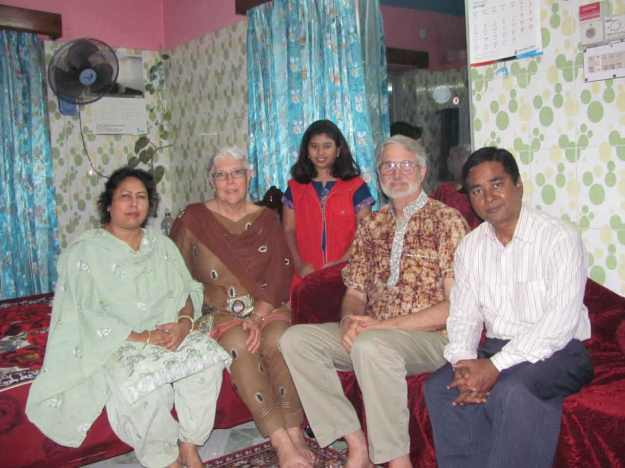 Aunt'is mom, Aungti, and her father posing with us in their bedroom-family room