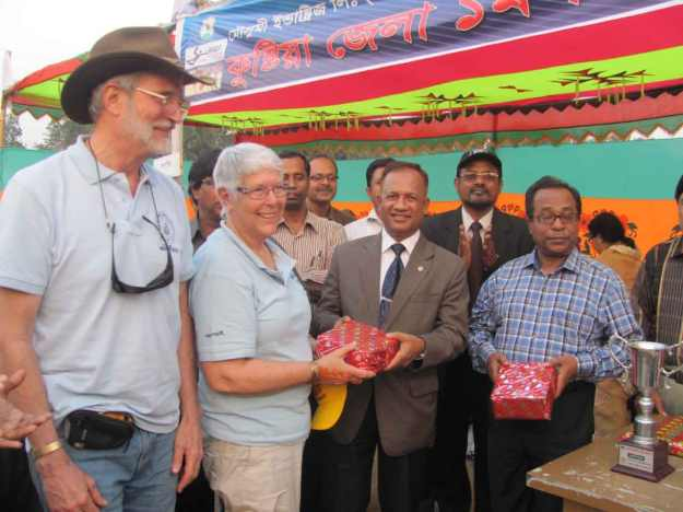 Receiving gifts presented by the Kushtia District Commissioner and local party leader