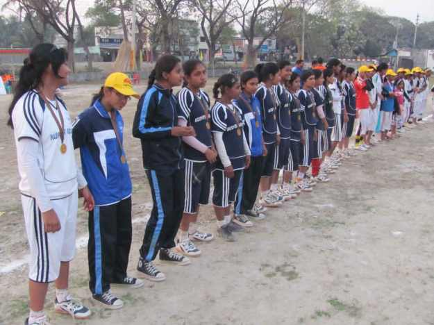 The handball tournament finalist teams line up after the match to receive their gold or silver medal and trophy